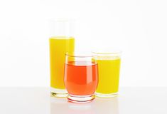 Glasses of fruit juice drinks Stock Image