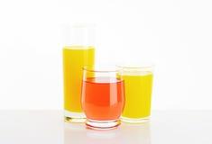 Glasses of fruit juice drinks Stock Image