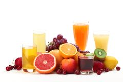 Glasses of fruit juice with fruits Royalty Free Stock Images