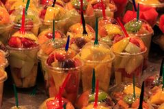 Glasses full of fresh fruit, stand in La Boqueria market, an old traditional market in Barcelona, famous landmark.  royalty free stock photography