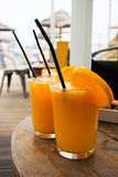 Glasses full of fresh squized orange juice Royalty Free Stock Images