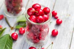 Glasses full freshly picked cherries raspberries Stock Photo