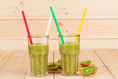 Glasses full of tasty kiwi juice. Royalty Free Stock Images
