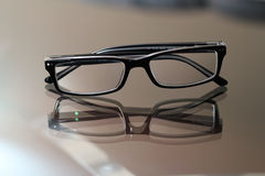 Glasses on a glass table stock image