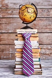 Glasses on globe and tie. Stock Photography