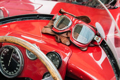 Glasses and gloves inside a vintage red car Stock Photos