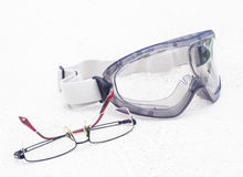 Glasses and goggle on floor Royalty Free Stock Photo