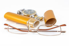 Glasses in gold case. And watch shot on white background Royalty Free Stock Photo