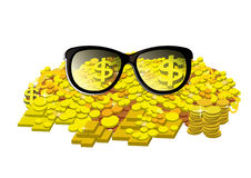 Glasses with gold coin and bullion Stock Photo