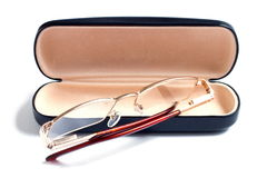 Glasses of gold color and case to them Stock Photography