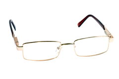 Glasses of gold color for dull sight Royalty Free Stock Photos