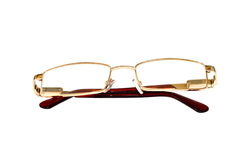 Glasses of gold color for dull sight Royalty Free Stock Photography