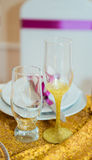 Glasses with a gold dusting royalty free stock photography
