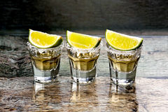 Glasses of gold tequila Royalty Free Stock Photos