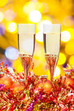 Glasses, gold Xmass balls on blurry background 6 Royalty Free Stock Photo