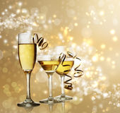 Glasses on Golden Sparkling Background Stock Photos