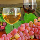 Glasses and grape by a vineyard Royalty Free Stock Images