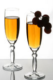 Glasses and grapes Stock Images