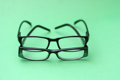 Glasses on green   background Royalty Free Stock Photo