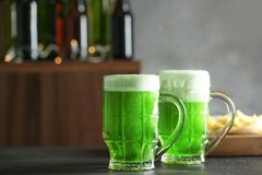 Glasses of green beer on table in bar. Saint Patrick`s day celebration Stock Photo