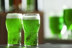 Glasses of green beer on table in bar. Saint Patrick`s day celebration Royalty Free Stock Photos
