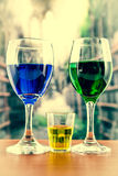 Glasses with green and blue cocktail yellow shot Royalty Free Stock Photos