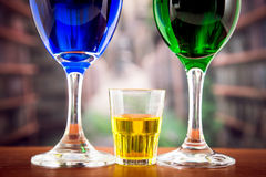 Glasses with green and blue cocktail yellow shot Royalty Free Stock Photo