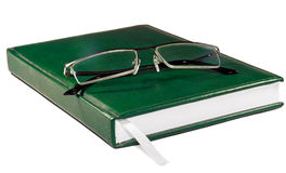 Glasses on the the Green Book Royalty Free Stock Image