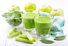 Glasses of  green juice with apple and spinach Stock Photos