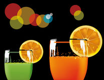 Glasses with green and orange drink Royalty Free Stock Photo
