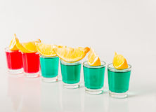 Glasses with green and red kamikaze, glamorous drinks, mixed drink poured into shot glasses. Party set royalty free stock photo