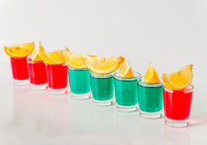 Glasses with green and red kamikaze, glamorous drinks, mixed drink poured into shot glasses. Party set stock image