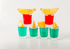 Glasses with green and red kamikaze, glamorous drinks, mixed drink poured into shot glasses. Party set royalty free stock image