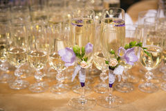 Glasses of groom and bride Royalty Free Stock Images