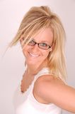 Glasses and Hair Model. Young blonde woman smiles while wearing eyeglasses and white tank top shirt stock image