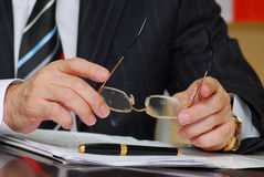 Glasses in hand. During a briefing stock photo