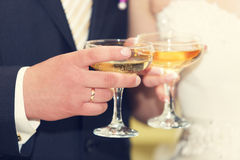Glasses in hand bride and groom. Royalty Free Stock Photography