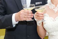 Glasses in hand bride and groom. Stock Image