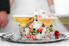 Glasses in hand bride and groom. Stock Photos