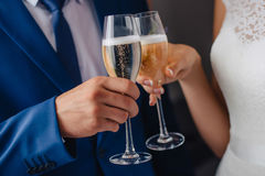Glasses in the hands of the bride and groom. Wedding Royalty Free Stock Photos