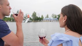 Glasses in hands man and female view from back, rest on water, male and woman drinking wine on yacht, happy couple drink stock video footage