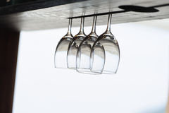 Glasses hang up side down in the beach front Royalty Free Stock Images
