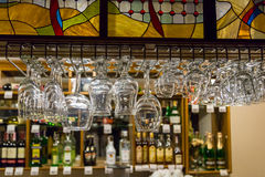 Glasses hanging above the bar Stock Photo