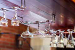 Glasses hanging in the bar Royalty Free Stock Photos