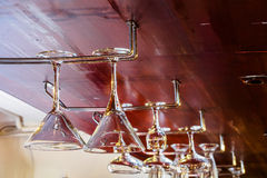 Glasses hanging in the bar Royalty Free Stock Images