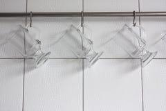 Glasses hanging on hooks Royalty Free Stock Image