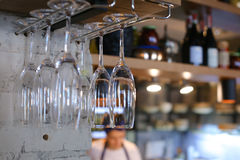 Glasses hanging upside down in cafe restaurant wine Stock Images
