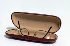 Glasses With Hard Case. A pair of glasses in an opened hardcase Stock Photo