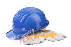 Glasses hard hat and gloves. Royalty Free Stock Images