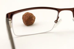 Glasses and Hazelnut Stock Photos
